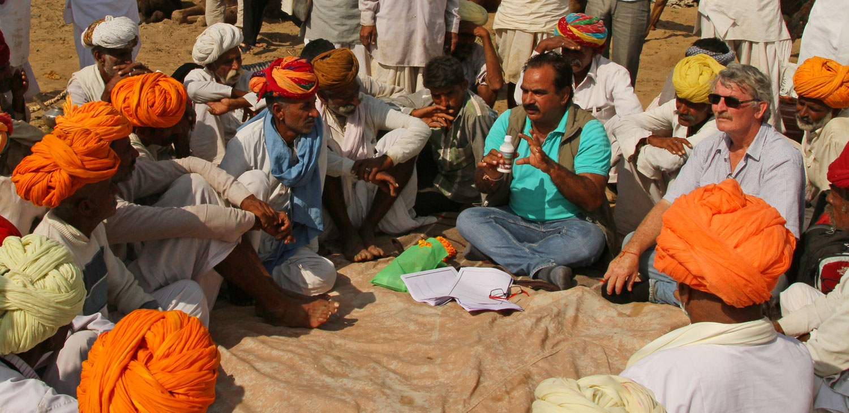 Hanwant Singh Rathore of LPPS and Australian camel expert Paddy McHugh discussing camel milk dairy production with Raika camel breeders during Pushkar Fair.