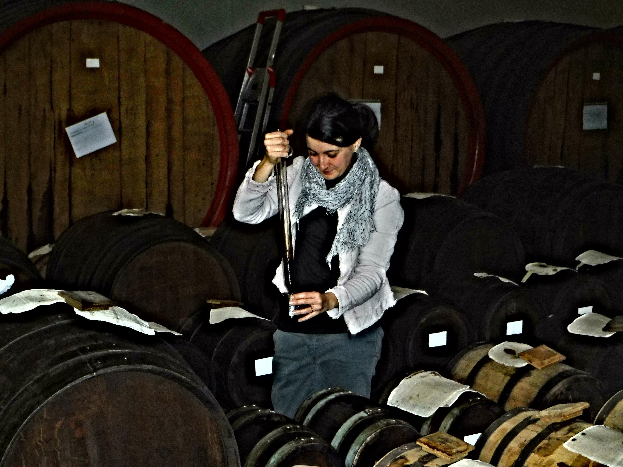 9. Hand filling aged balsamic vinegar.JPG