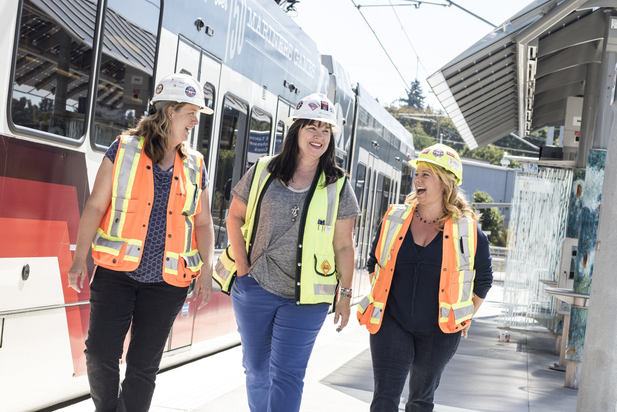 Engineers Leah Robbins, Teresa Boyle, and Stacy Bluhm tour the new Tacoma Street Max Stop on the TriMet Orange Line.