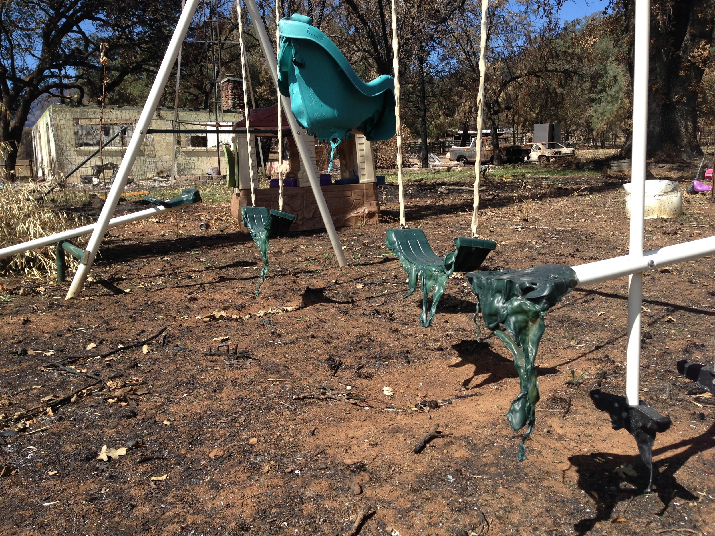 Swing set partially melted in The Valley Fire