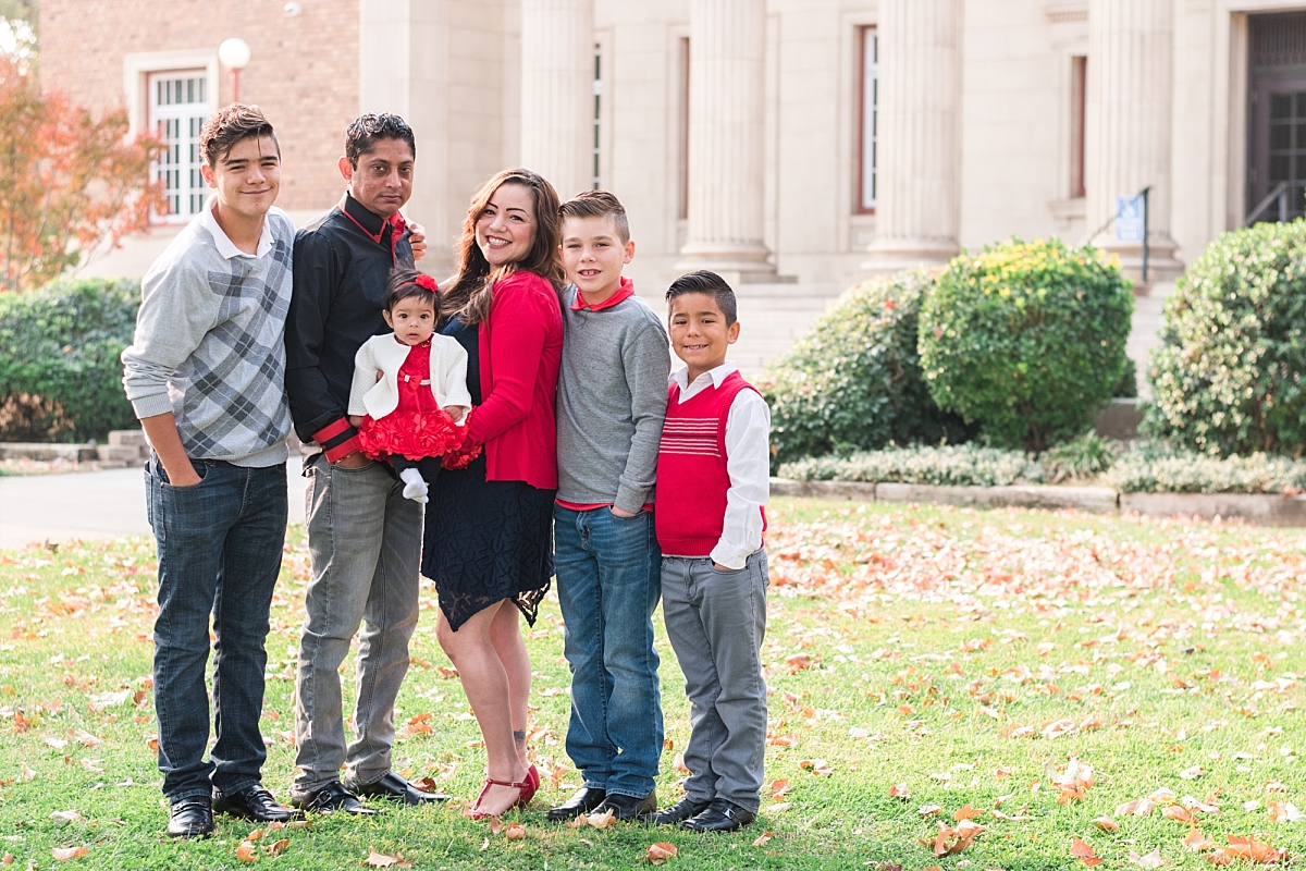 family portraits vintage courthouse white columns marble entry red gray black outfits_0319.jpg