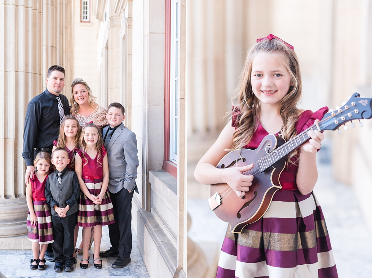 Christmas Family Session with vintage columns and marble floors maroon and gold dresses_0029.jpg