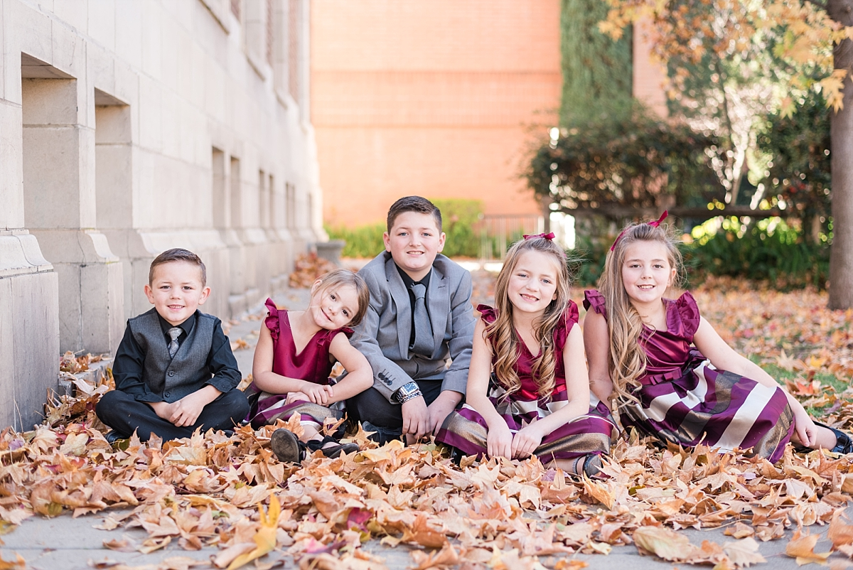 They has so much fun throwing the leaves up, so I had them sit down in them and this turned out to be my favorite of the kiddos!! LOVE IT!