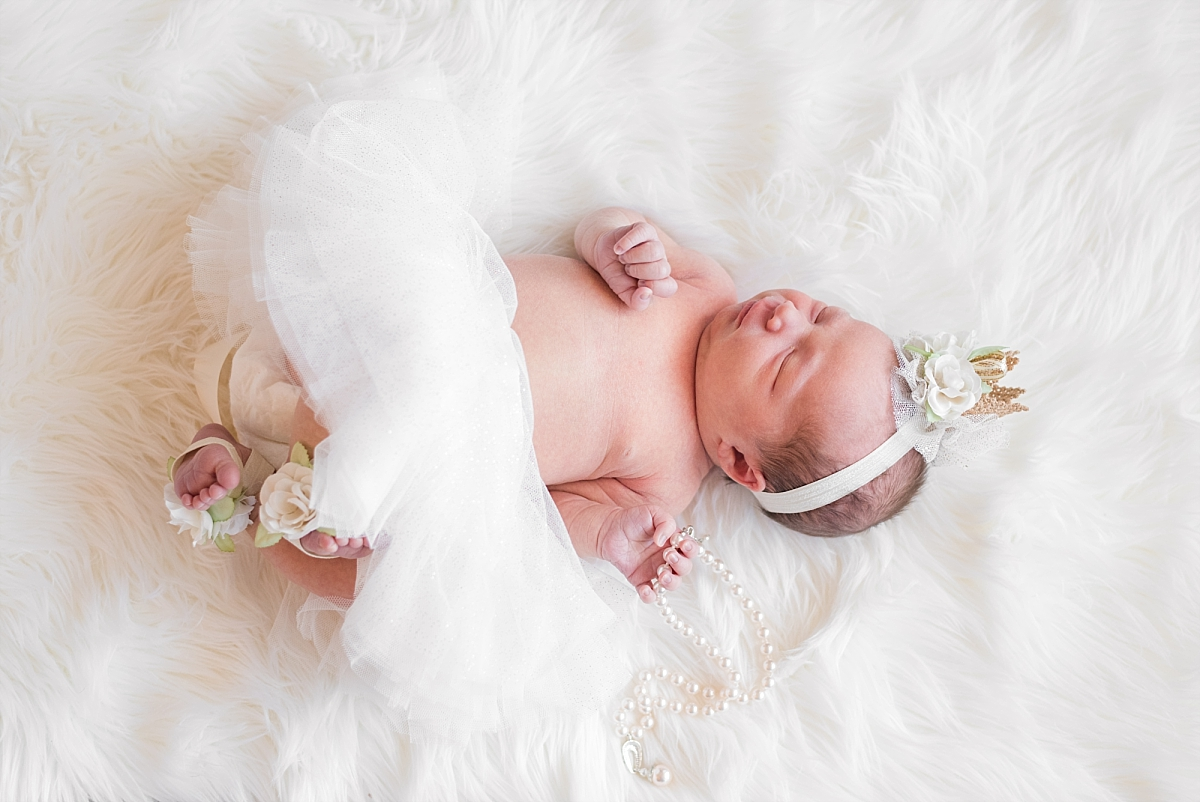 newborn princess on wedding dress and antlers_0084.jpg