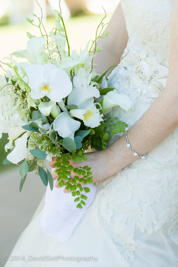 Beautiful bouquet by Clementine Floral, the bride carried a handkerchief of her late father.