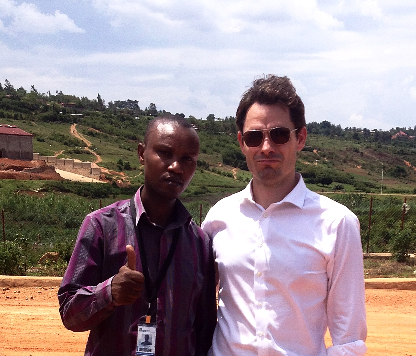 Locus Economica's Michael Castle-Miller with SEZAR Engineer Innocent Nizeyimana, at the site of KSEZ's planned wastewater treatment plant