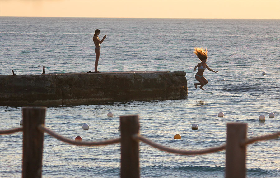 Jumping off the Jetty at  Playa Azul  - Cozumel, Mexico