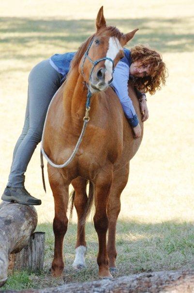 Maddrey draped across a horse's back