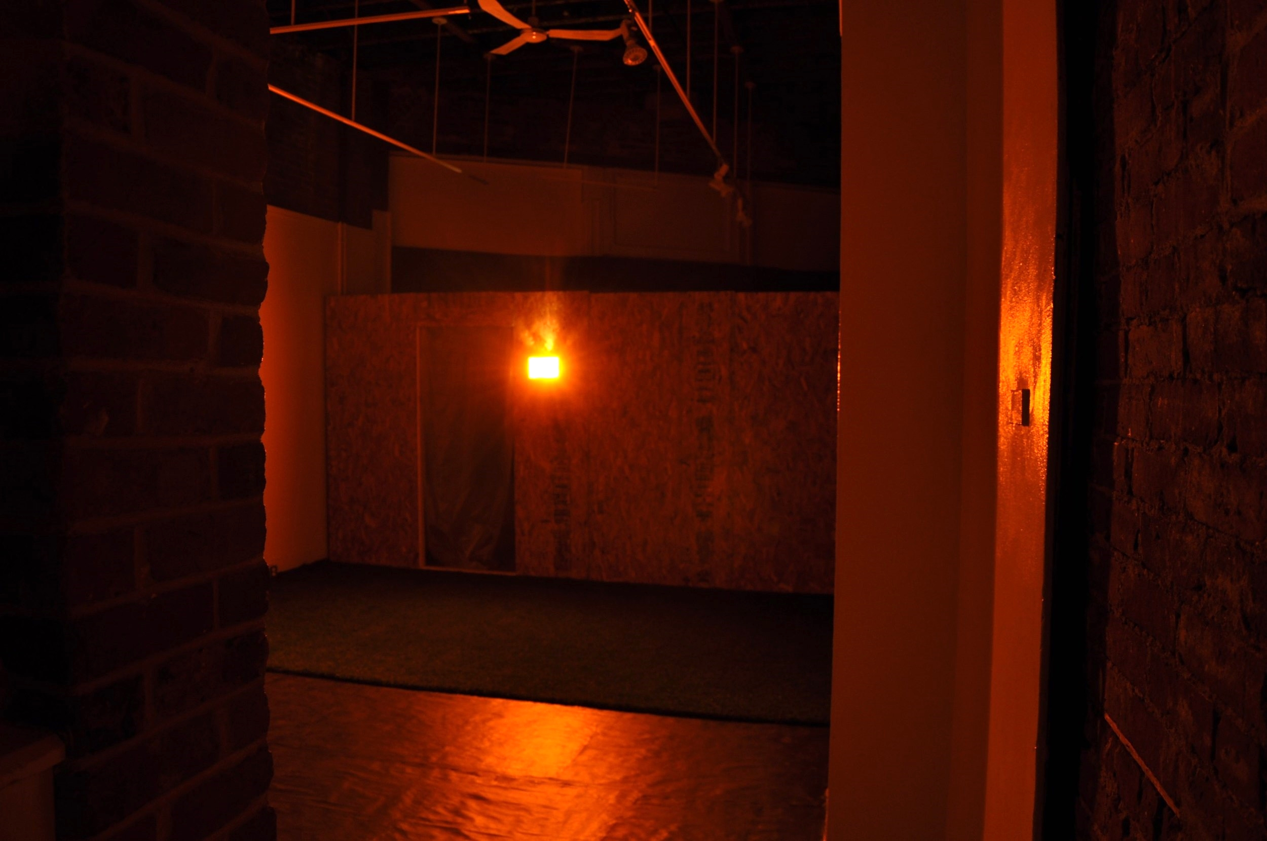 Disorientated Concessions (3 AM) ,2013,Chipboard, wood, tar paper, vapour barrier, fake grass, acrylic, motion detector  Dimensions: 4.9m x 8.2m x 4.8m
