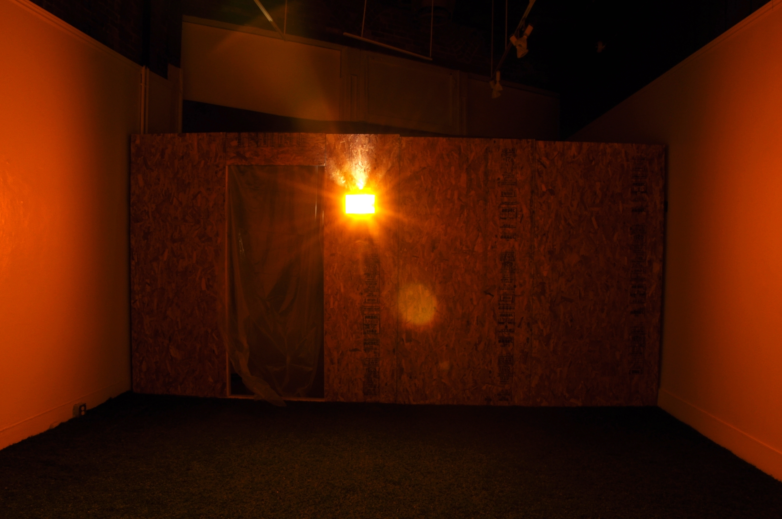 Disorientated Concessions (3 AM) , 2013, Chipboard, wood, tar paper, vapour barrier, fake grass, acrylic, motion detector  Dimensions: 4.9m x 8.2m x 4.8m