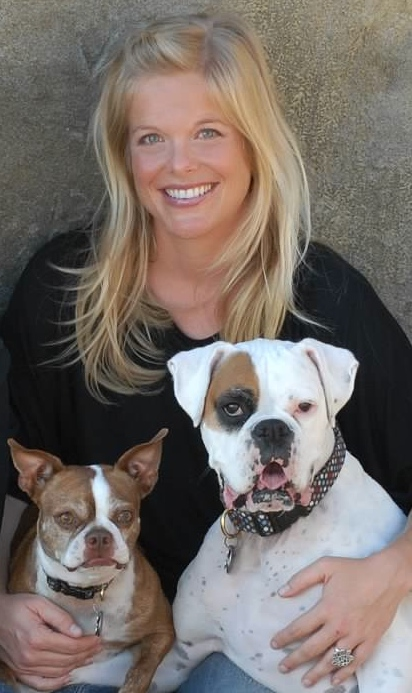 Shannon Lerach with two of her precious pups, Frances the red Boston Terrier and Chloe the white Boxer. Chloe is trained as a therapy dog and often works in conjunction with Shannon, providing emotionally supportive therapy to supplement trauma treatment.