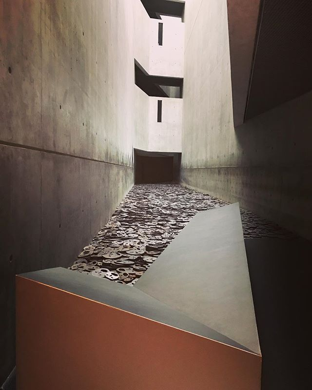 "This space is called the ""Void of Memory"". The faces are cut out of steel plates up to about 2 inches thick and the sound it makes when people walk on them just echoes like the hollowest, loneliest sound you've ever heard. . . . . . #jewishmuseum #liebskind #art #experience"