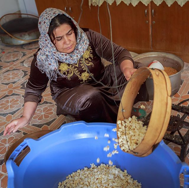 """""""A family with three daughters can't survive on popcorn."""" Shiwan makes a large batch of popcorn that her husband will sell on the street - it's how they survive now. Before they were displaced by ISIS, they had a farm - and Shiwan was the farmer. Her husband's medical condition prevented him from doing the labor, so she did it - it was hard, but rewarding. She was able to support her family - a rare female breadwinner in rural Iraq, and proud of it. Now without farmland or education, she feels powerless to provide for her daughters. As enterprising as it might be, popcorn is not enough. ——————————————————————- Sharing work produced for @womenforwomenuk @womenforwomen about the unique and layered livelihood challenges that women face post-conflict in Northern Iraq. January 2018.  #powerfulwomen #refugees #womenwhoshootfilm #womeninfilm #iraq #displacement #documentary #documentaryphotography #women #womenempowerment #popcorn"""