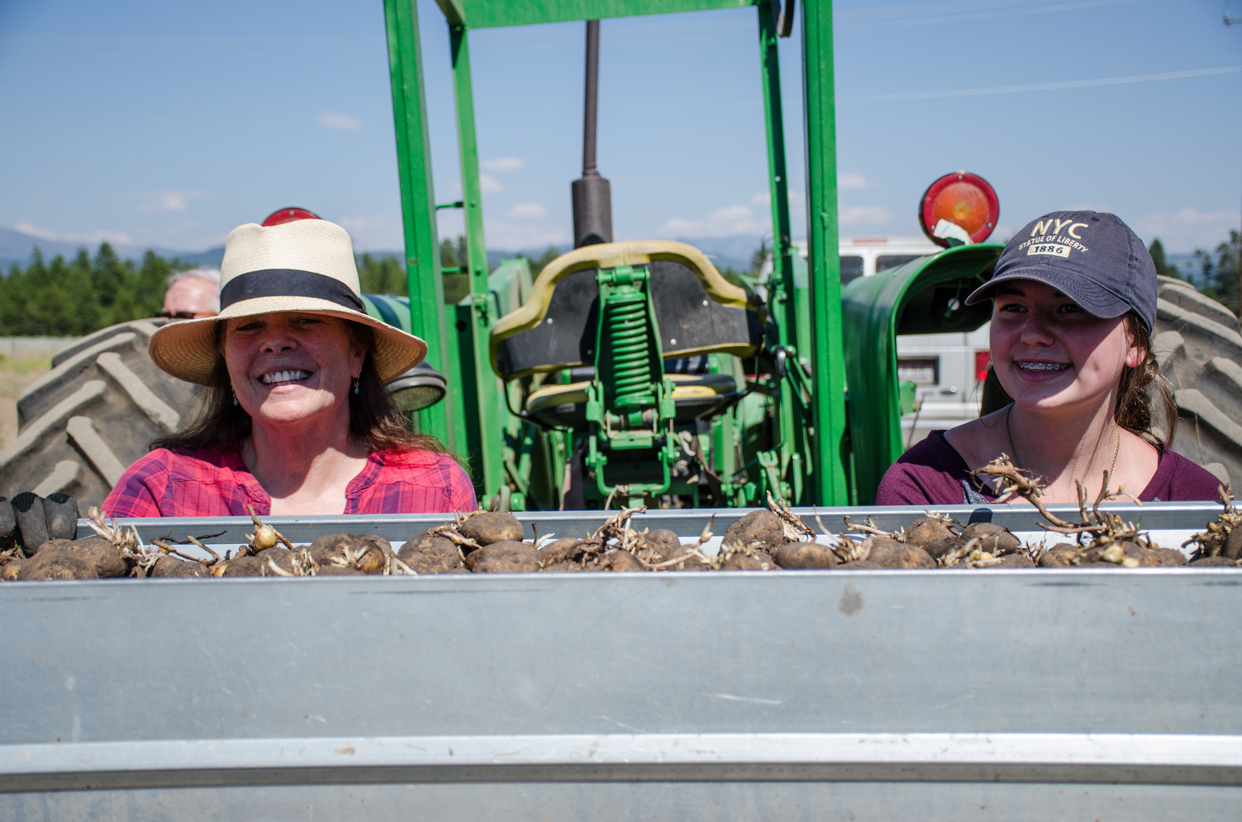 Sandy Bragg of Everything Potatoes, INC. teaches a MOSS student how to plant seed potatoes
