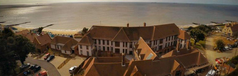 Rear view of The Bartlet, showing the sea beyond - Aerial photography provided by Gipping Homes Ltd.