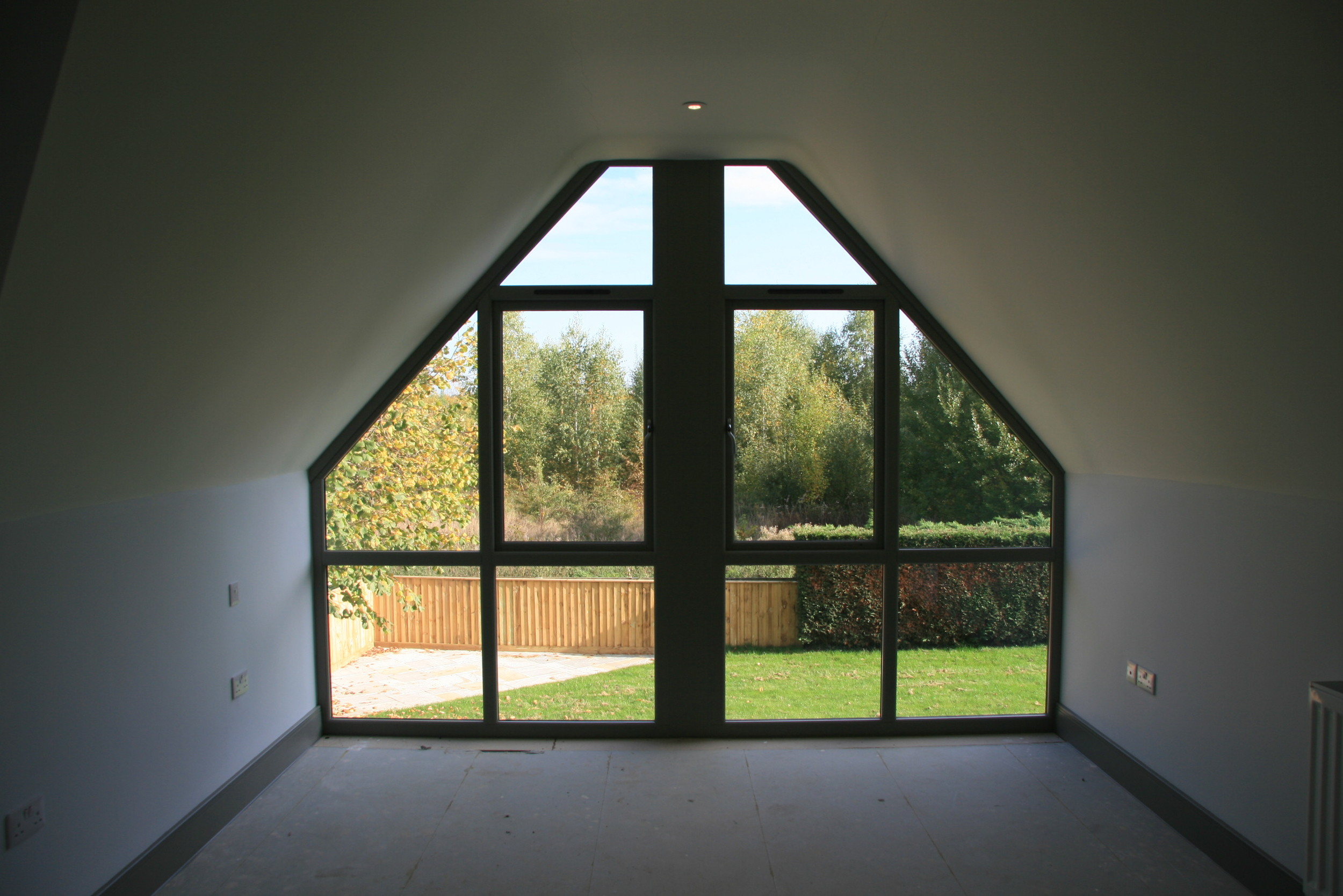 The design incorporates the landscape, with its large windows and bi-folding doors bringing the outside in.