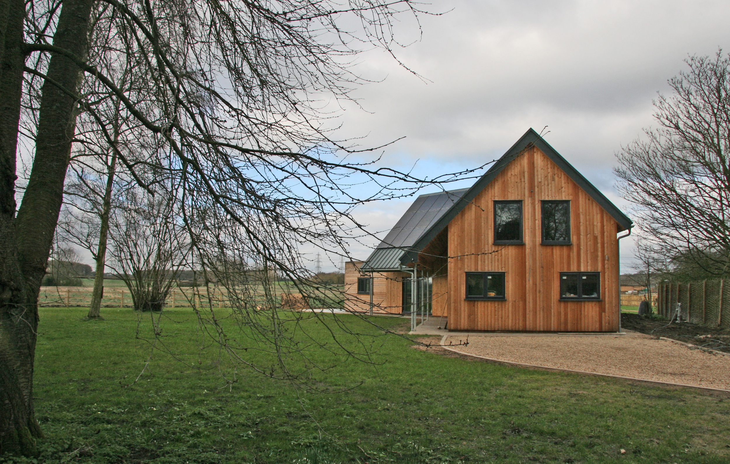 The house aims to exemplify low energy housing, reducing inputs of energy, whilst maintaining user comfort. The new dwelling incorporates; much higher than statutory required levels of insulation triple glazing, and building air-tightness, Careful solar orientation & fenestration. Ground source heating & Photovoltaics, low energy fittings & appliances. Energy efficiency was high on the client's agenda, and the completed building has kept true to this initial brief.