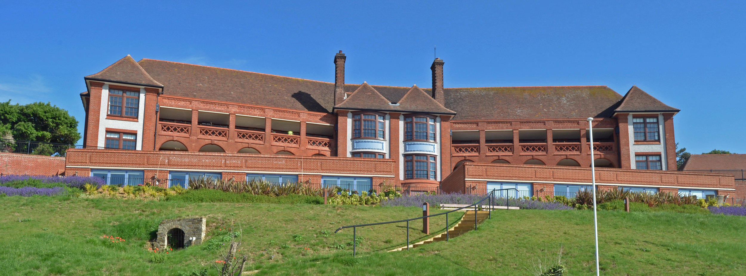 The Bartlet  Felixstowe   Winner of the RIBA Craftmanship Awards 2017, Restoration category.   Residential development of the former Grade II* listed Bartlet Hospital along with Cautley House to the west. The site is elevated on the north side of Undercliff Road East and benefits from commanding sea views. Planning and listed building consents were granted to convert the building into residential apartments and also includes for the erection of three new dwellings within the grounds.