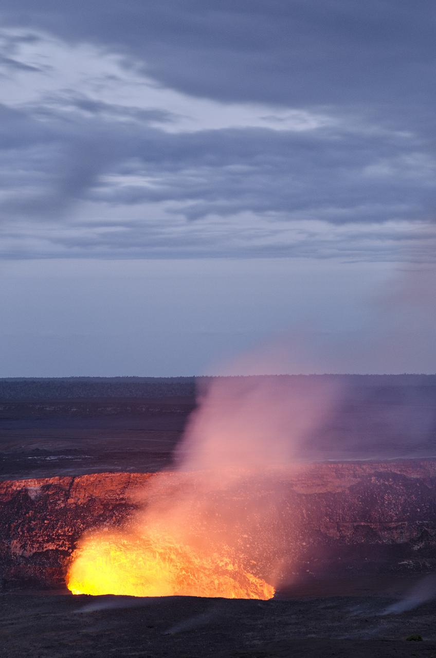 Kilauea Caledra's lava lake glowing red at susnset