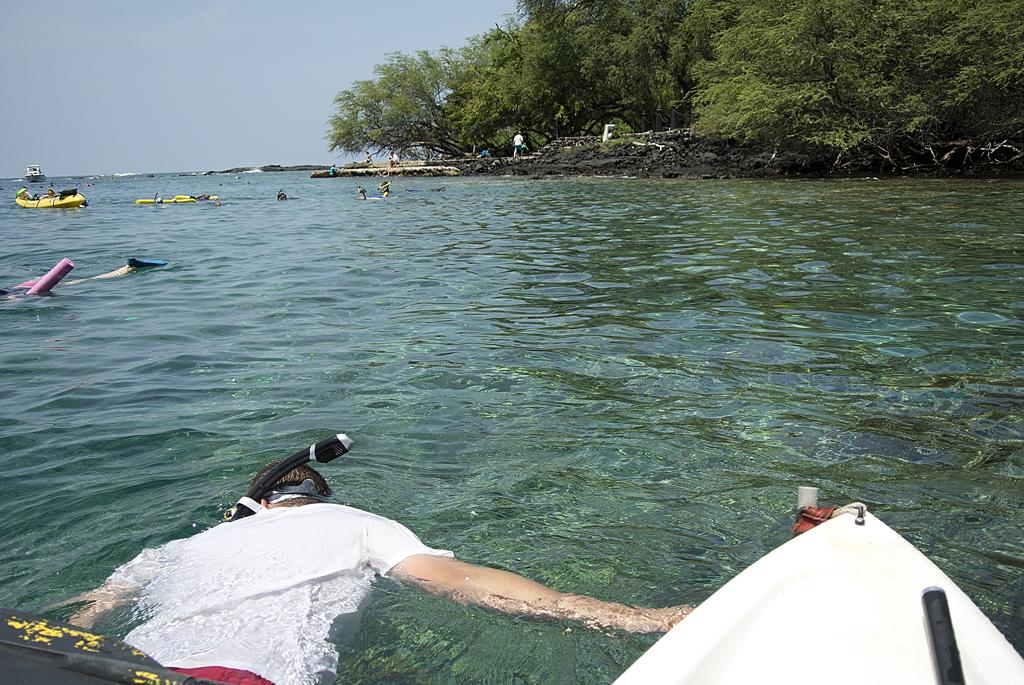 Hauling kayak while snorkeling