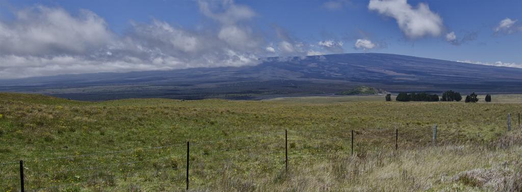 The enormous Mauna Loa volcano as seen from the slopes of Mauna Kea.