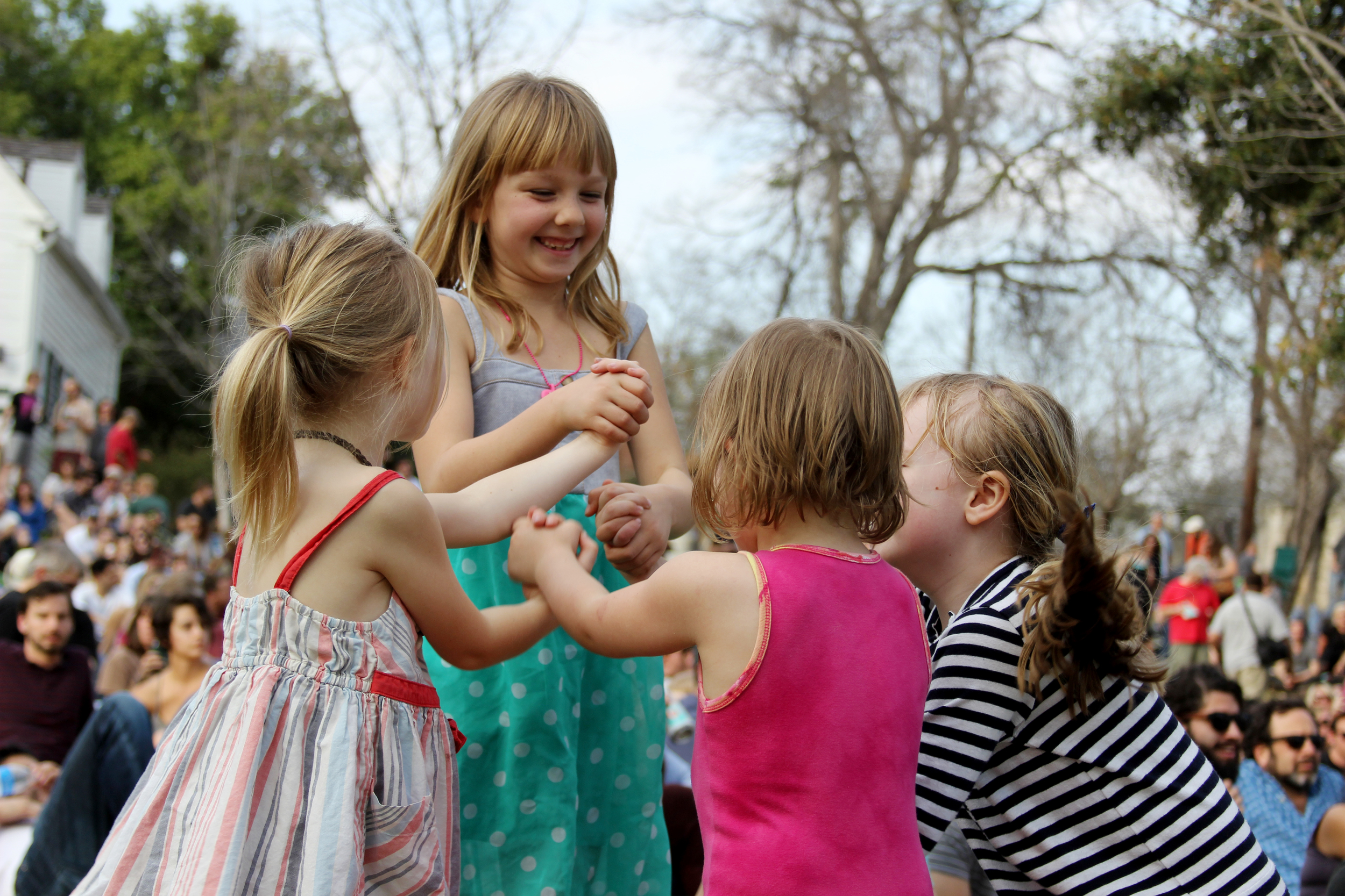 Little girls dance along to the live music at the French Legation Museum.   Photo by Tess Cagle