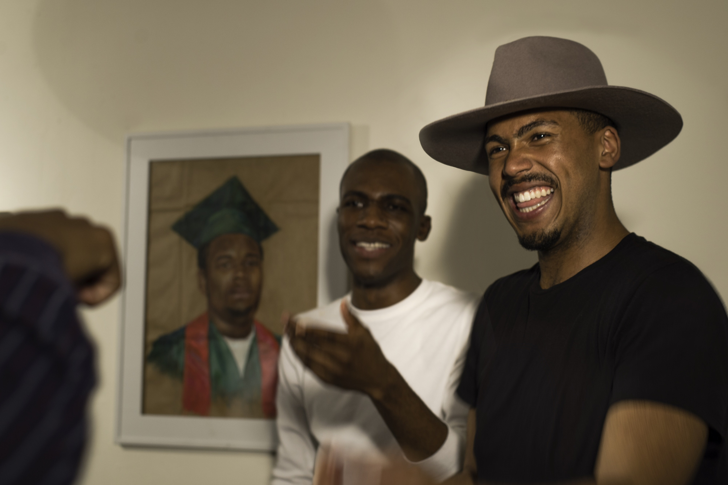 Hakeem Adewumi (left) and Johnathan Huggins (right) stand near a drawing of Michael Brown.