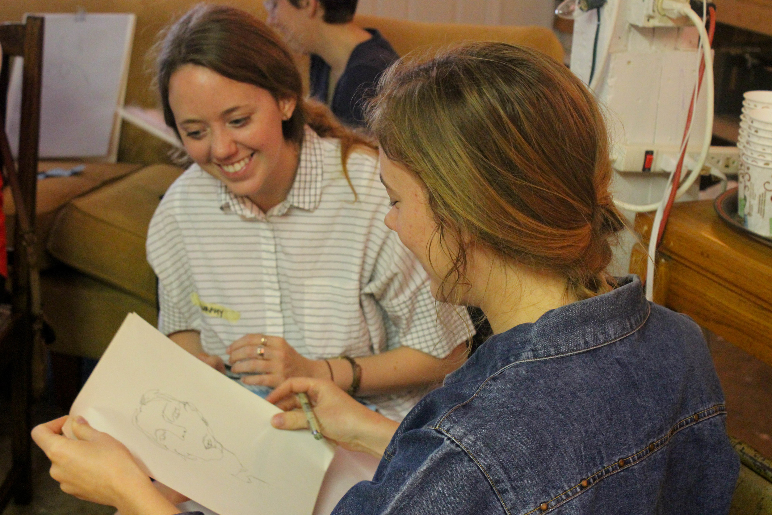 Murphy Anne Carter (left) and Bronwyn Walls (right) look at their first figure drawings.