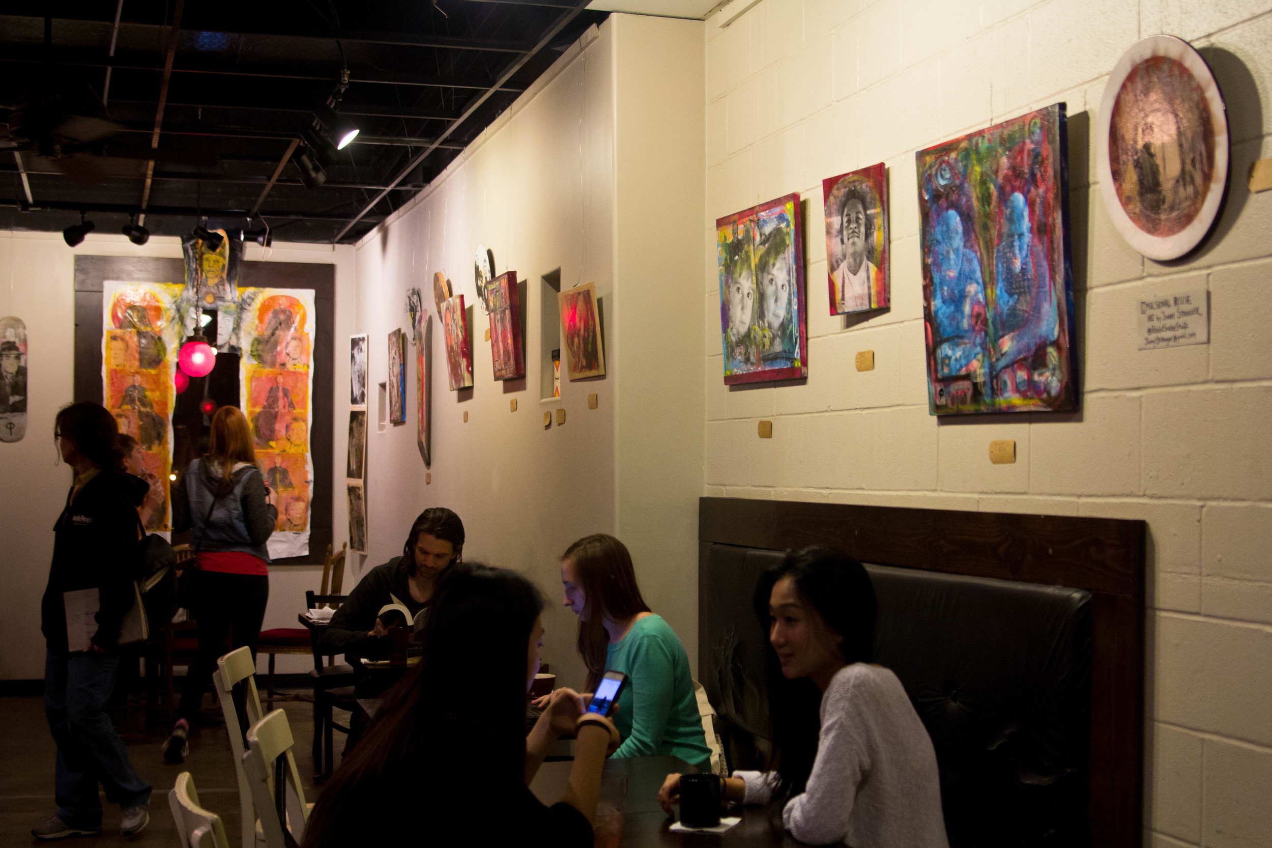 Patrons enjoying coffee and art at Once Over Coffee Bar.