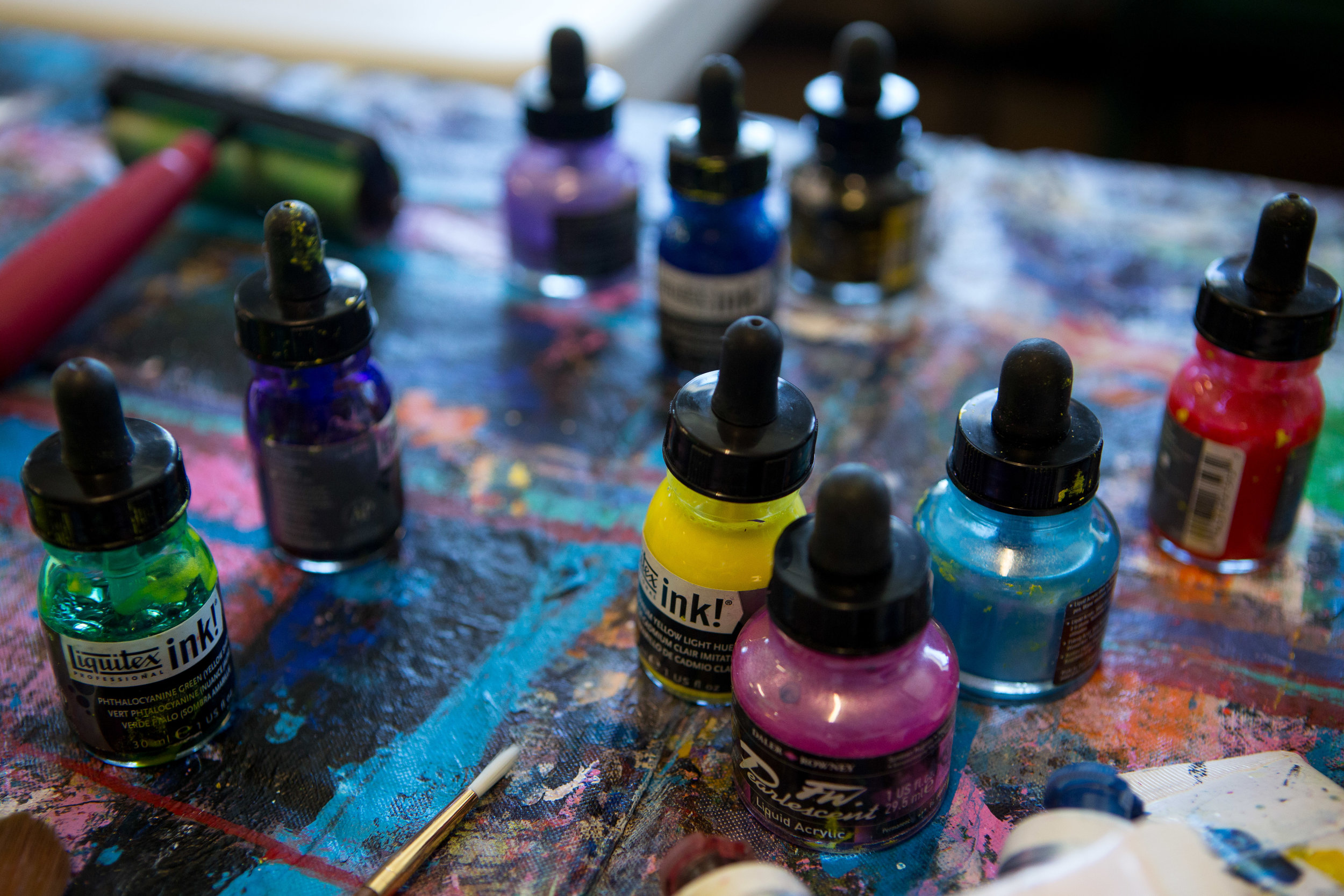 Various acryclic paints are laid out on the table in the AFTS studio.