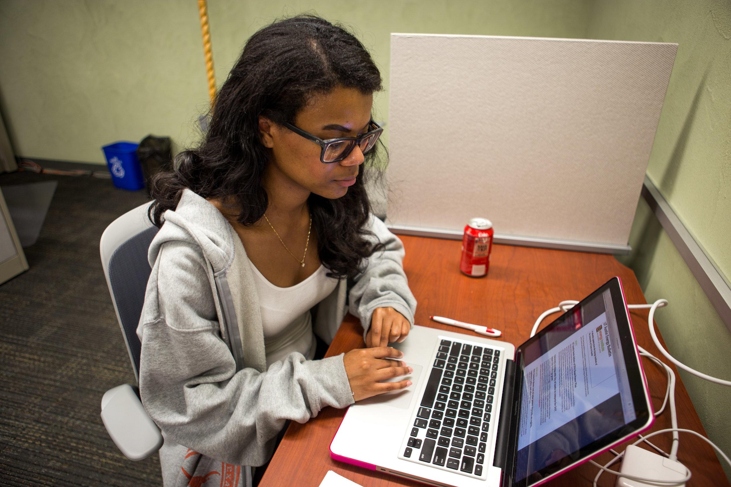 Journalism junior Alex Samuels types on her computer at her paid internship.