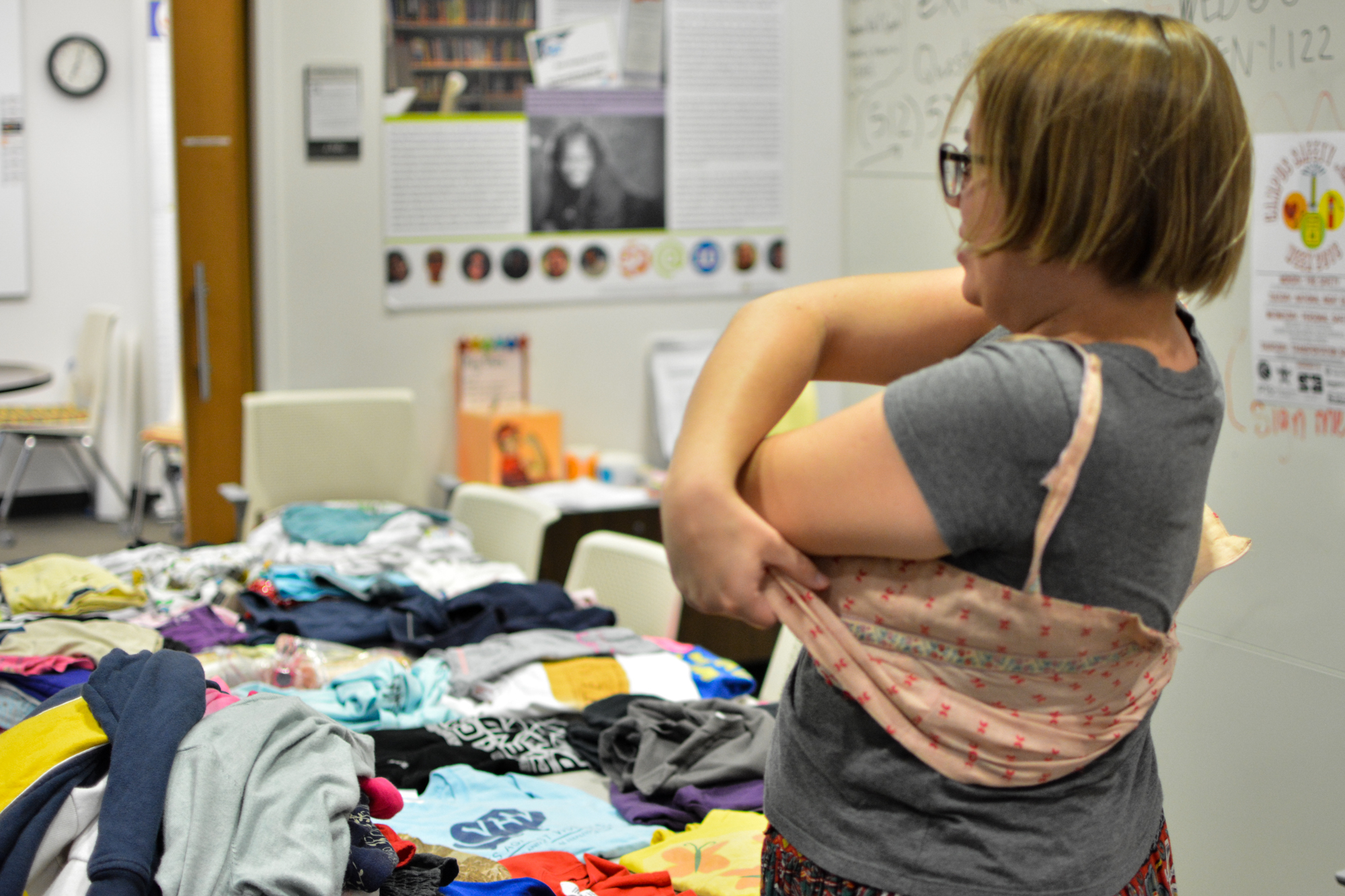 Many people, including volunteers, who attended the clothing swap got tried on various clothing items with the hopes of adding them to their own personal wardrobe.