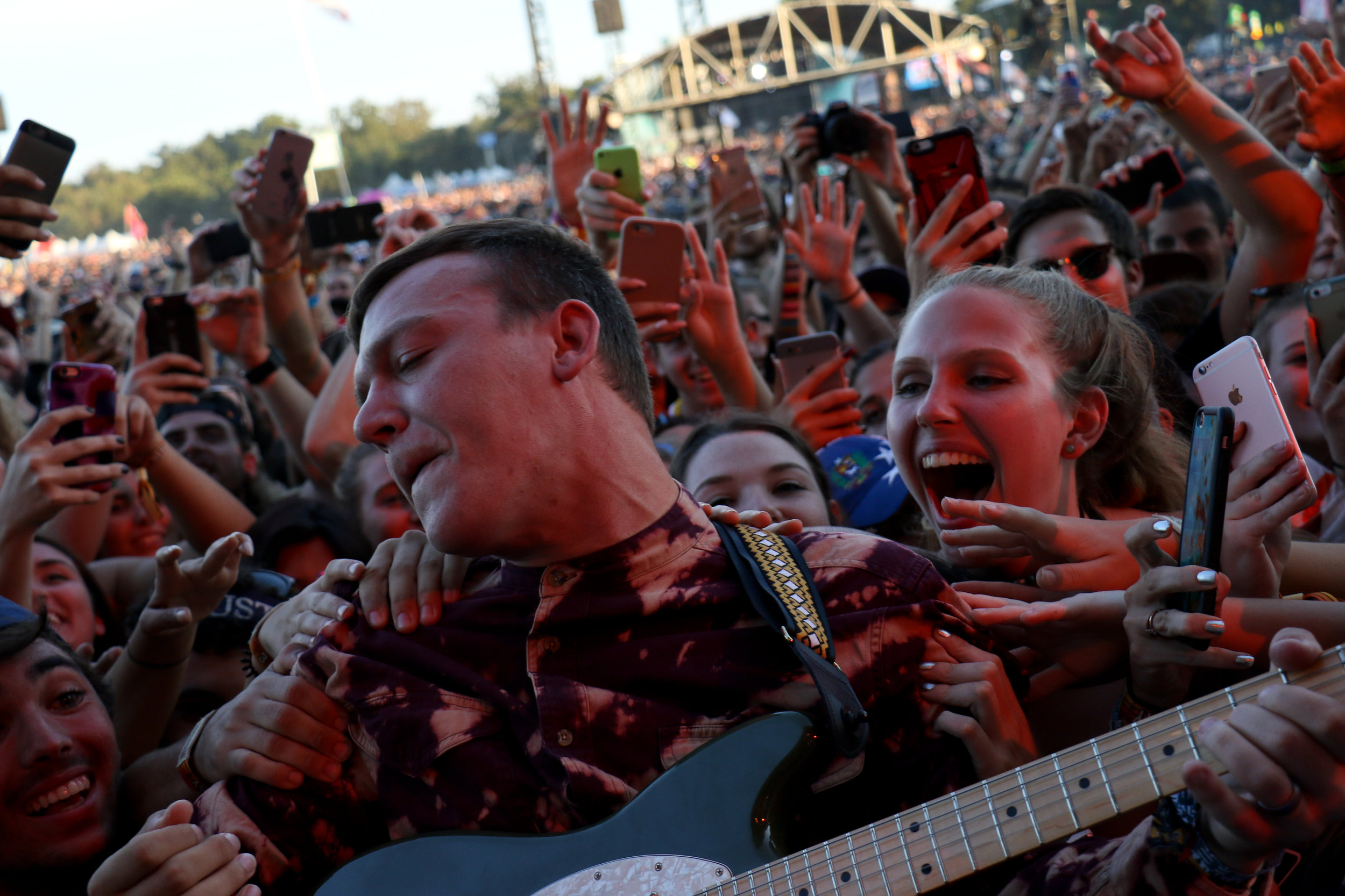 Brad Shultz of Cage The Elephant takes his guitar out to play with the fans.