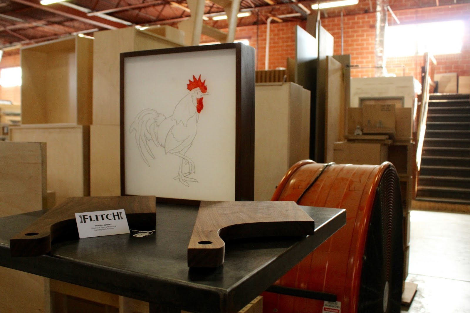 Flitch displayed their pieces in the middle of the warehouse that they work out of everyday.