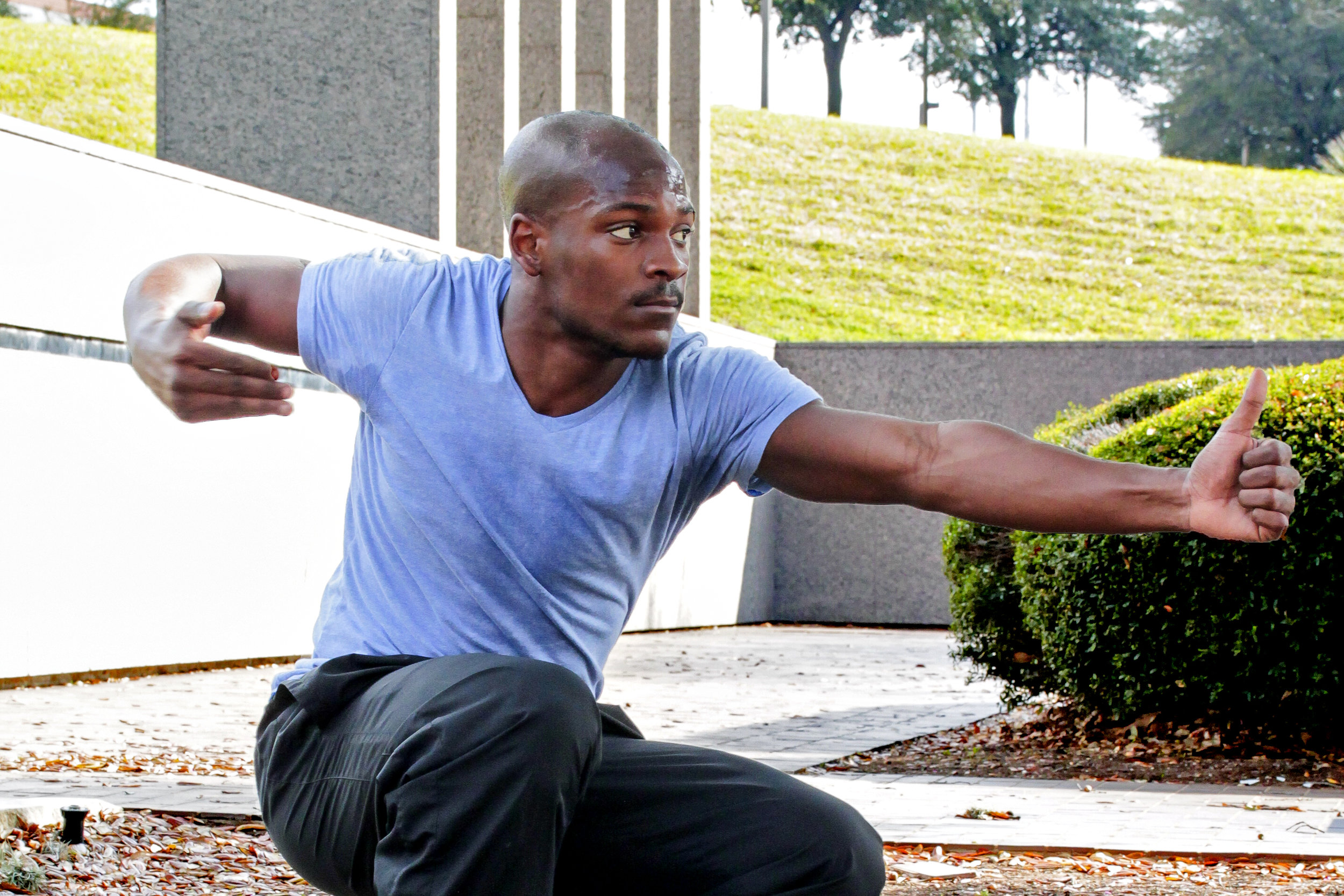 "Senior dance major and ""Momentum"" performer D'Lonte Lawson free styles in front of the Bass Concert Hall."