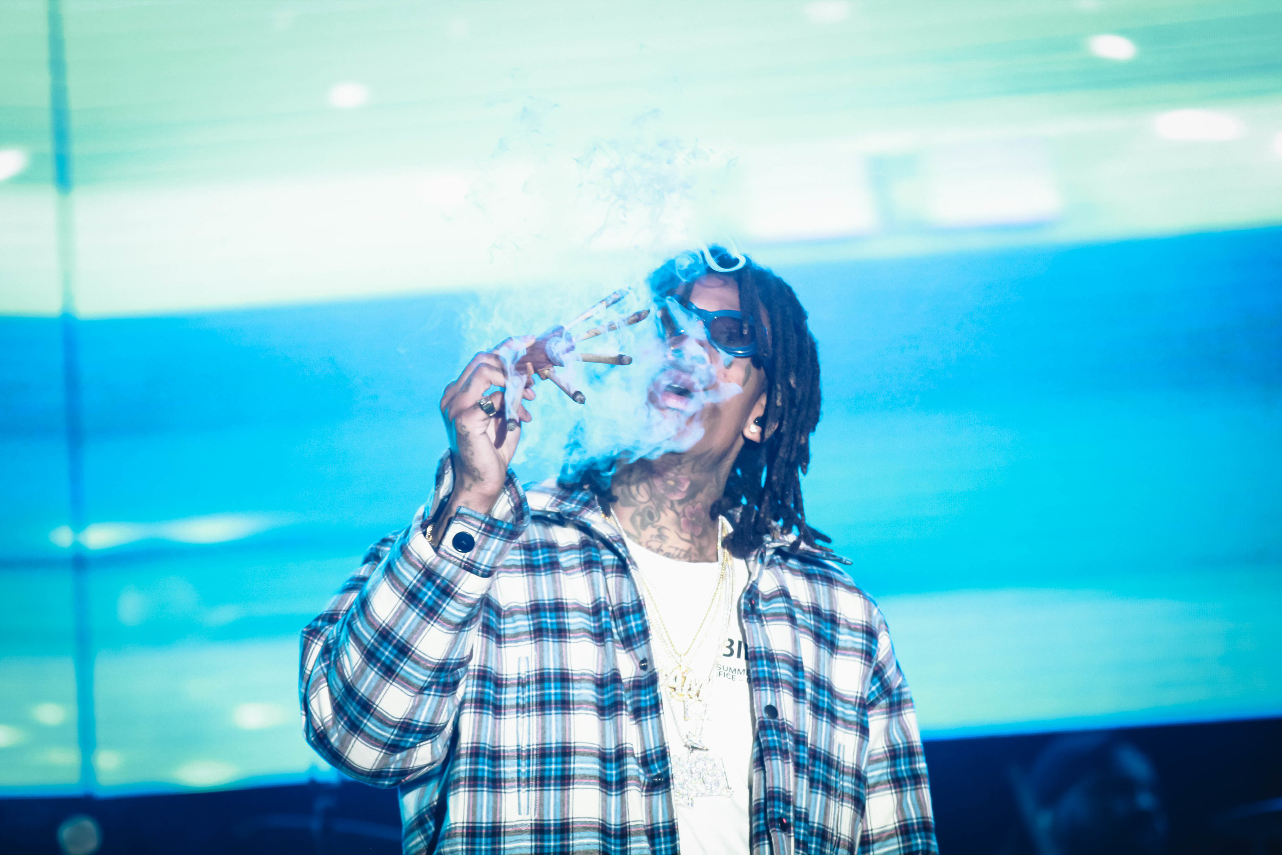 Wiz Khalifa's started his set by smoking five blunts in front of the chanting crowd.