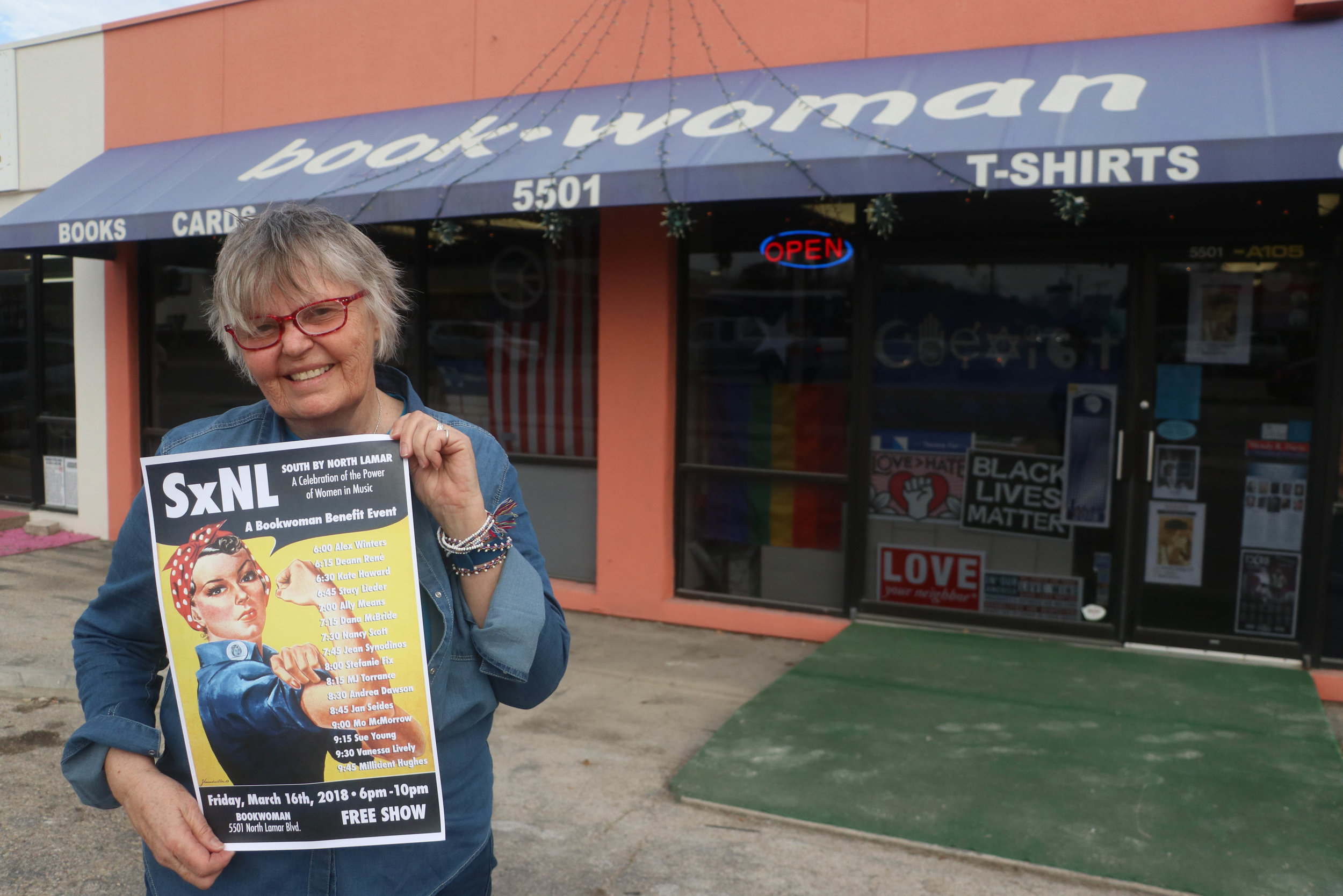 Susan Post, the owner of Bookwoman, displays her poster for South by North Lamar in front of her store.