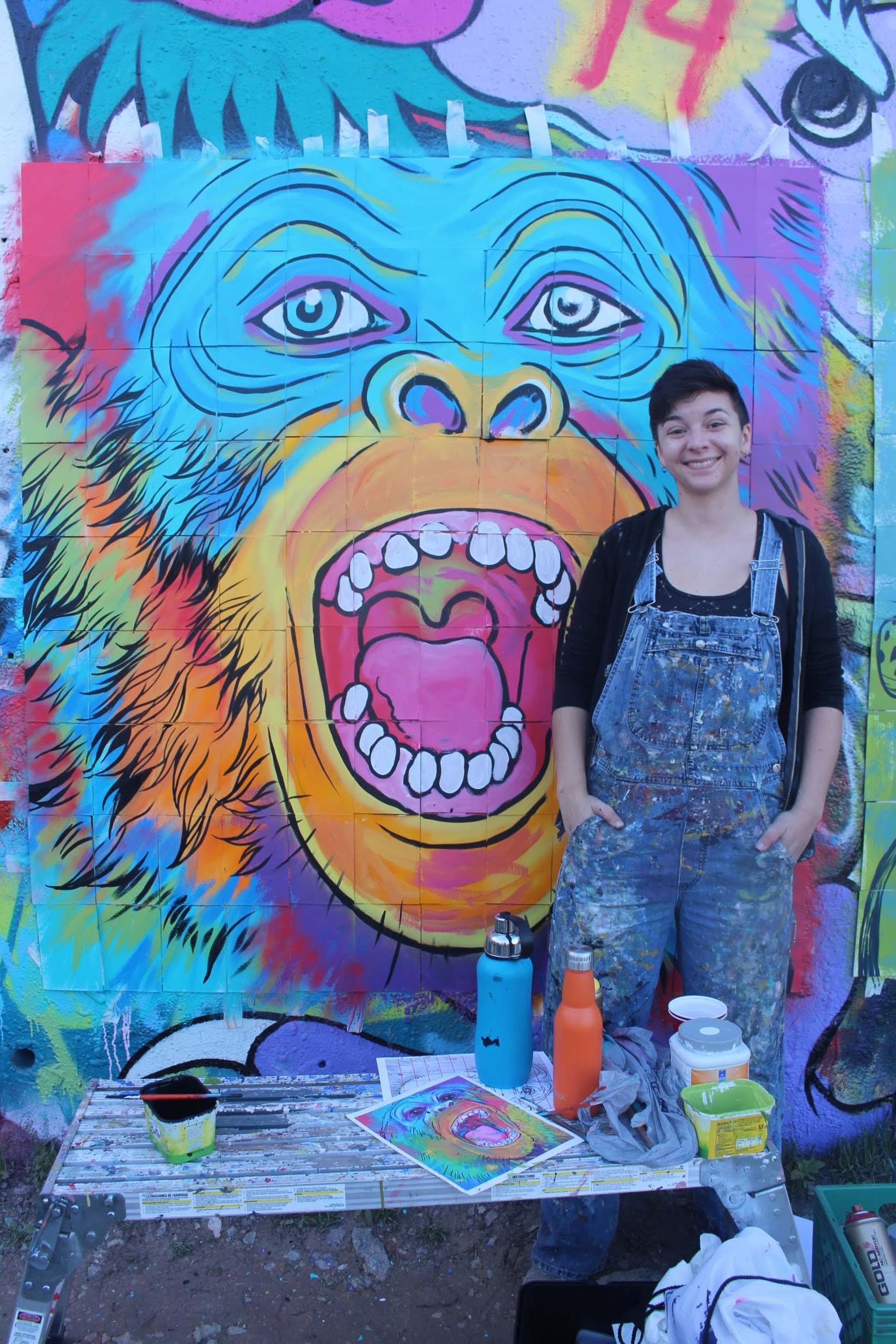 Aerica Raven Van Dorn poses with her nearly complete mural.