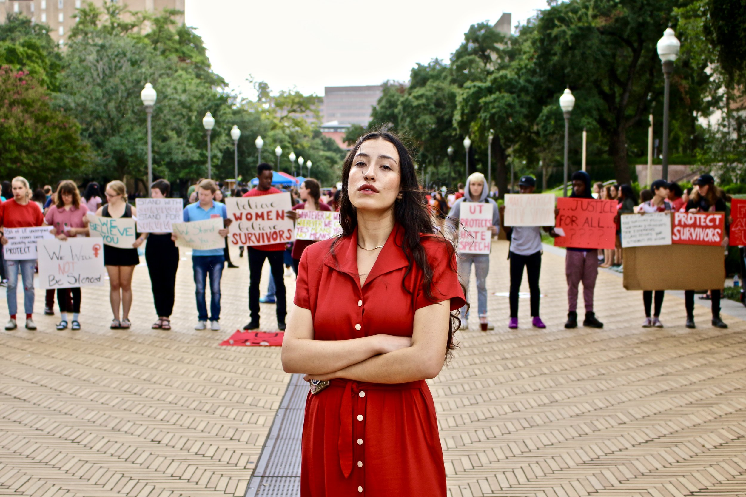 "Gabriela Garza, Jolt UT chapter president, stands in solidarity with students at the ""Stand with Survivors"" rally on Tuesday, Oct. 9."
