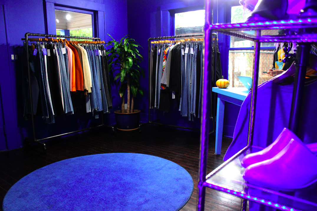 Inside the store, curated vintage items hang on the racks.