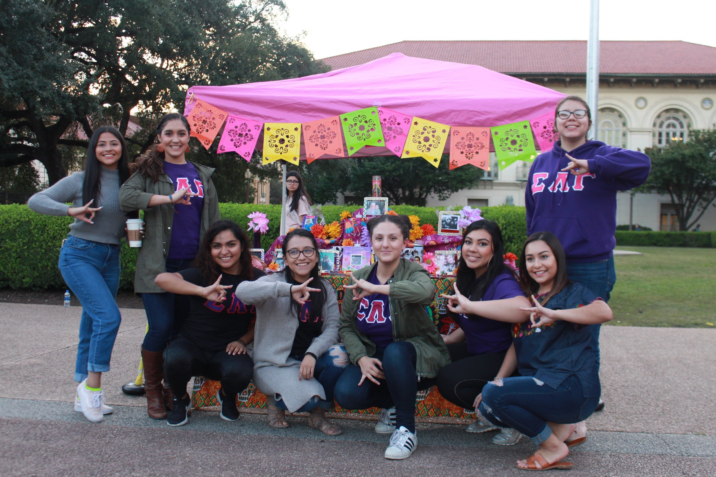 The women of Sigma Lambda Gamma proudly represent their name and their altar that is full of symbolism. From the colorful paper reminding viewers of the fragility of life, to the marigold's sweet scent which guide the dead towards the altar.