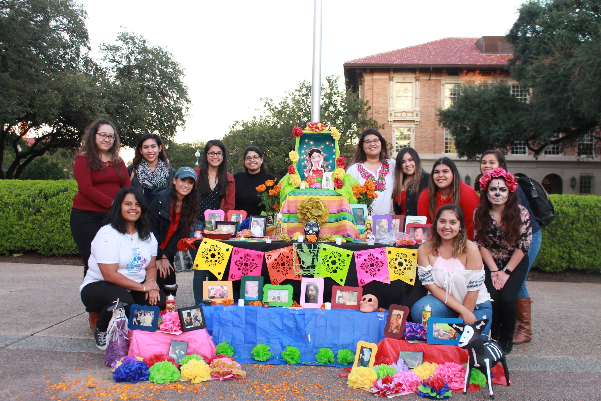 The women of Sigma Delta Lambda emphasize that their altar is more than just a theme. Rather, it shows a personal reflection inside each of their lives as they display those who have passed.
