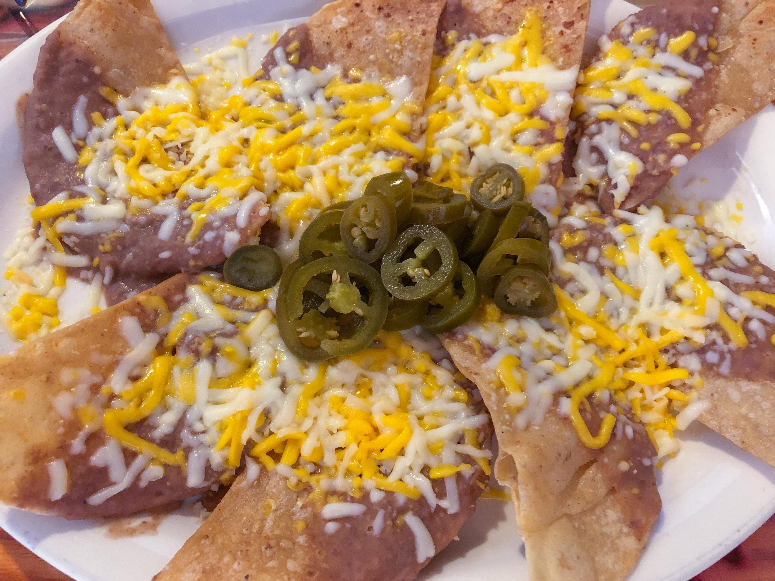 The bean and cheese nacho appetizer from El Secreto de La Abuela