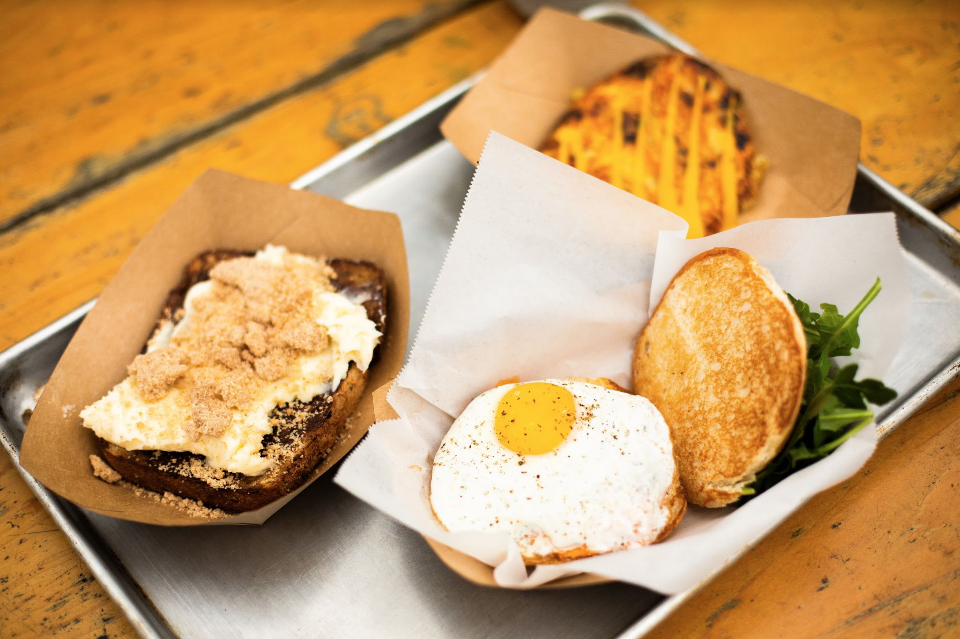 From left to right: Cinnamon Toast, the B.E.C, and a Crispy Cheddar Hashbrown.
