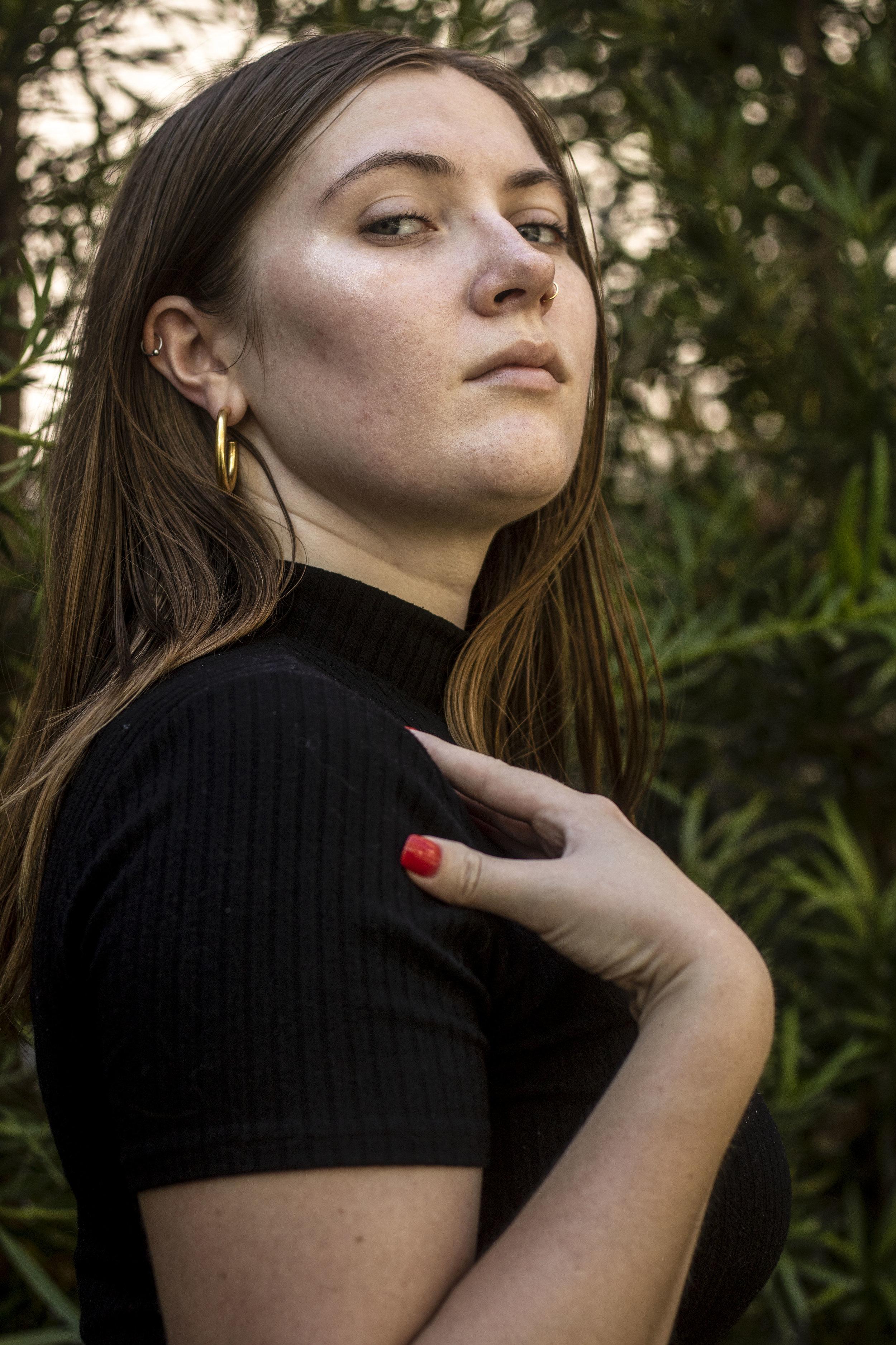 Savannah Olson is seen wearing a light makeup look.