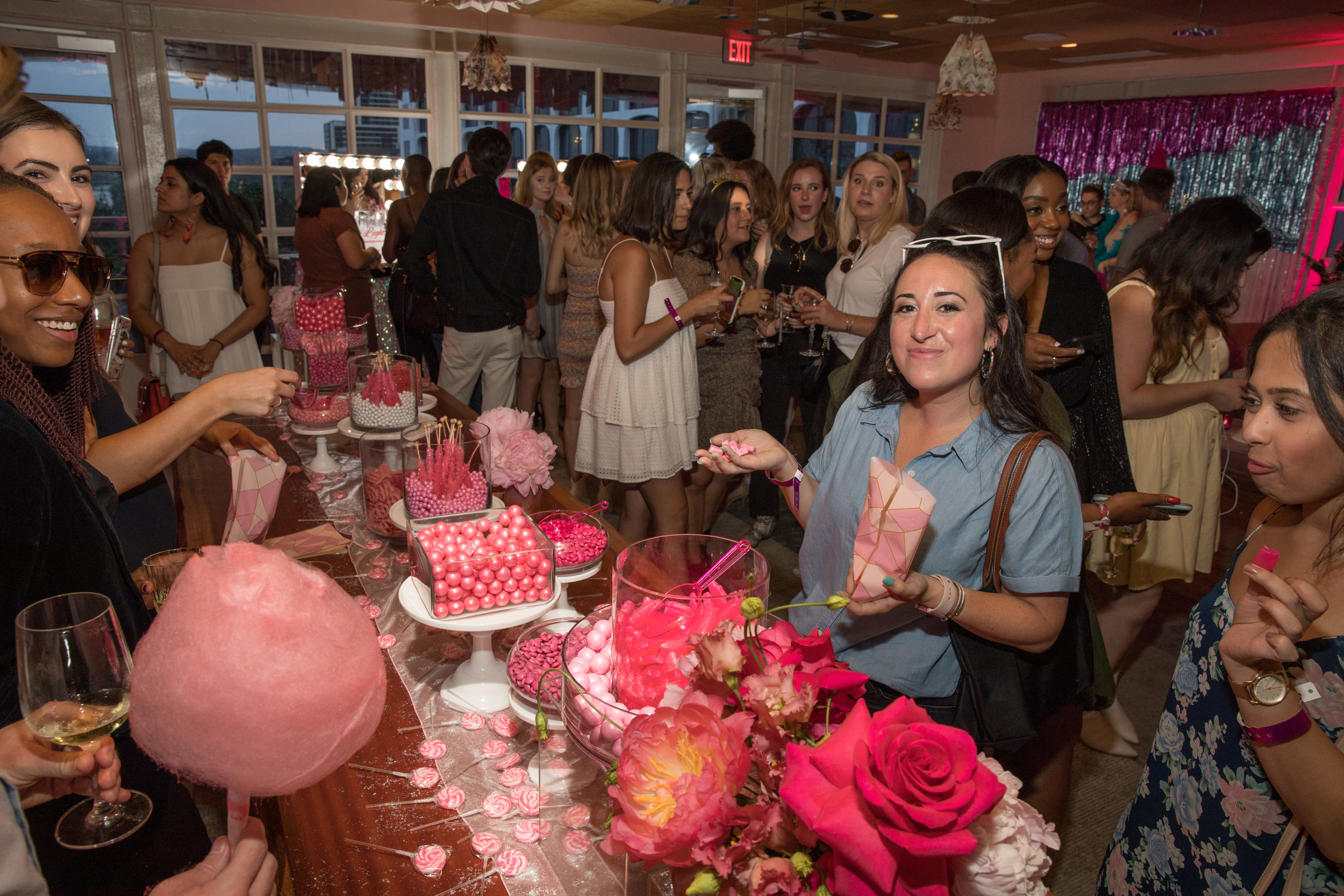 Guests enjoy the neatly organized, all-pink candy bar.