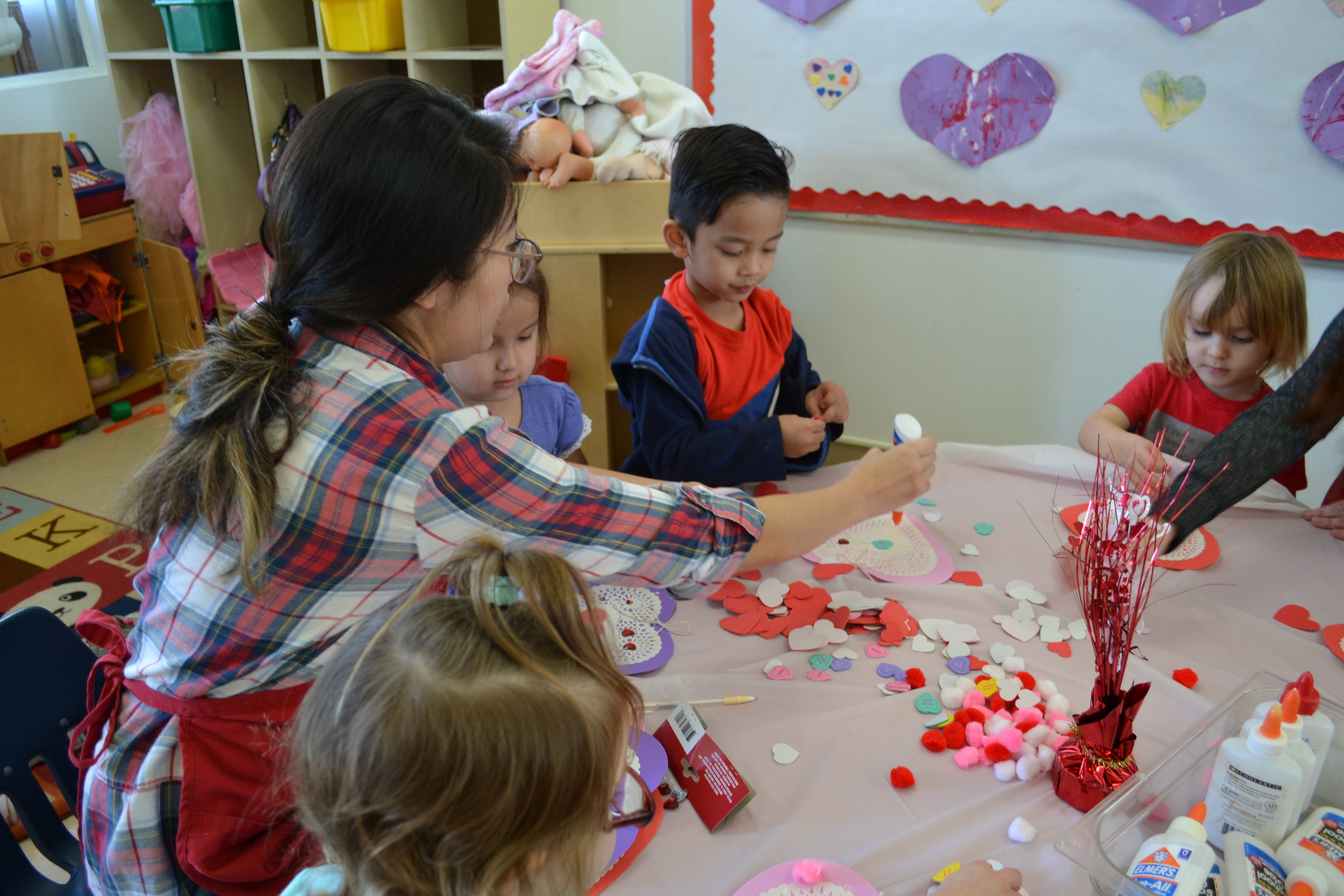 Room Parent assisting with valentine's day crafts