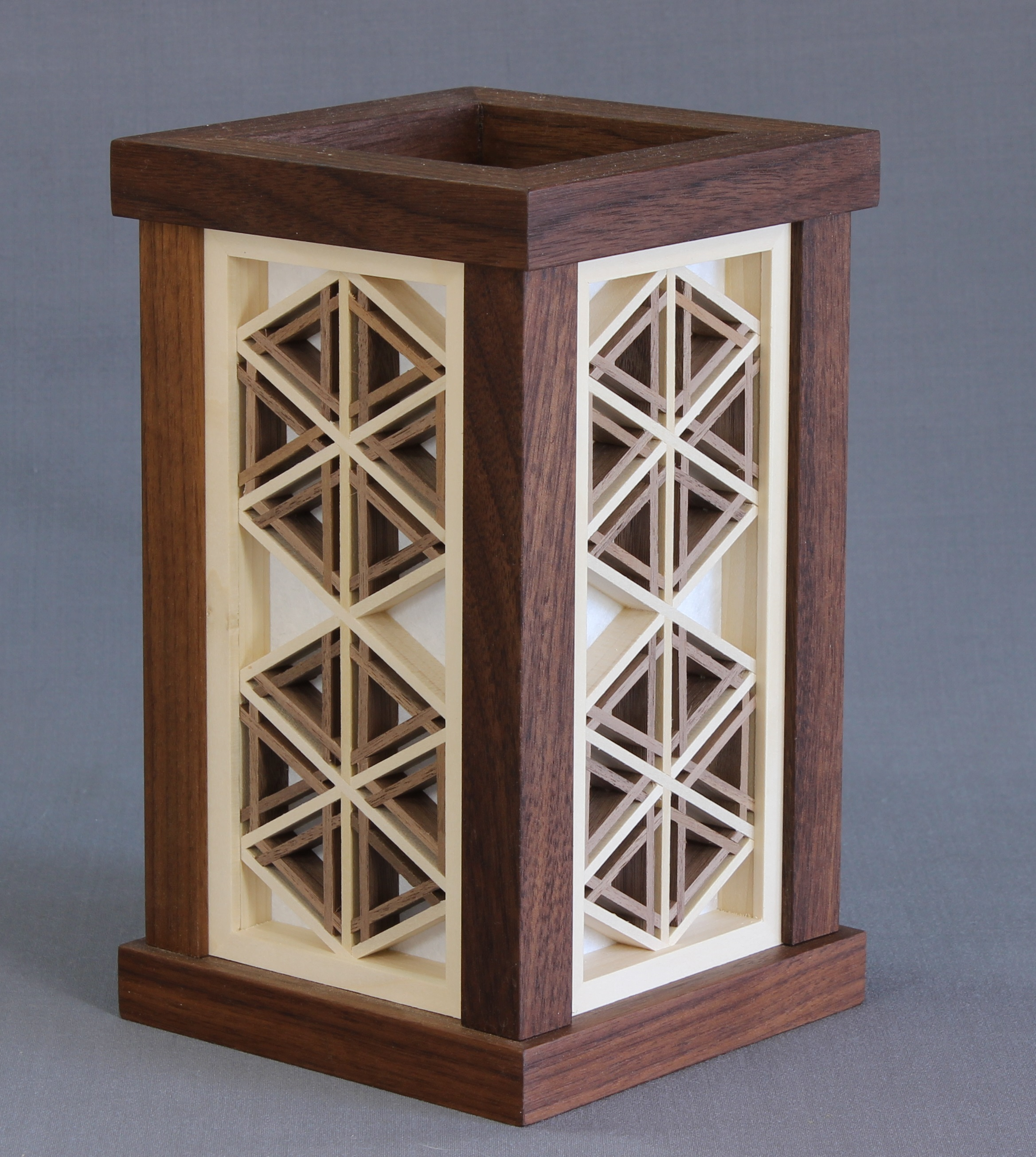 Andon Model #52   430.00 USD  8 7/8 x 5 5/16 x 5 5/16 inches  Shown in Walnut, made to order available in any domestic species.  Japanese shoji paper over wood.  Supplied with a led light fixture manufactured from UL listed parts.