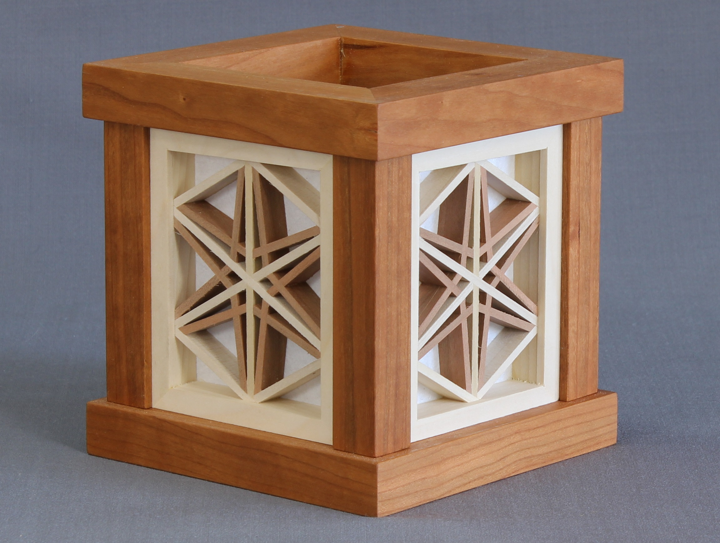 Andon Model #7   225.00 USD  5 ½ x 5 5/16 x 5 5/16 inches  Shown in Walnut, made to order available in any domestic species.  Japanese shoji paper over wood.  Supplied with a led light fixture manufactured from UL listed parts.