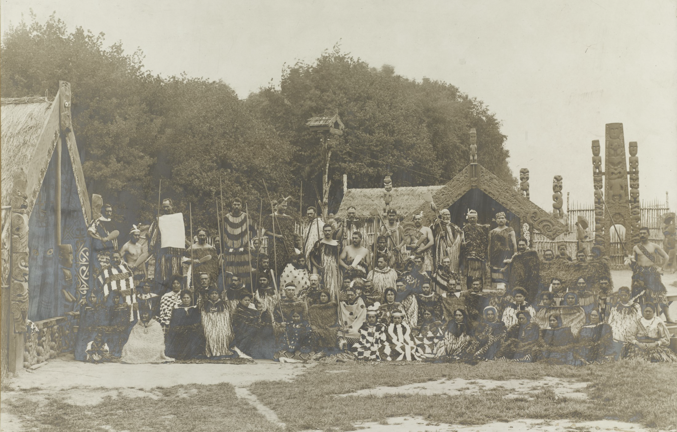 Group in ceremonial dress at the New Zealand International Exhibition, Christchurch, 1906-1907. Hocken Photographs Collection. James McDonald. Box-289-002.
